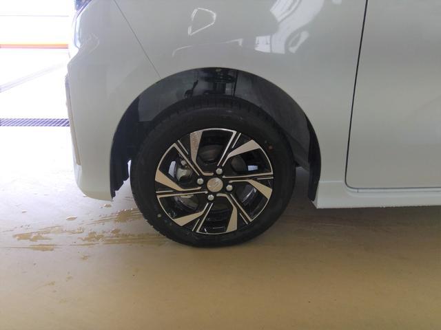 カスタムXセレクション 4WD スマートアシスト 両側パワースライドドア スマートキー LEDヘッドライト LEDフォグランプ オートライト オーディオレス オートエアコン 運転席・助手席シートヒーター 後席テーブル(24枚目)