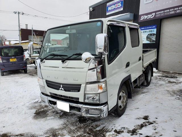 AT・4WD・エアコン・パワステ・冬タイヤ・後部ヒーター(2枚目)