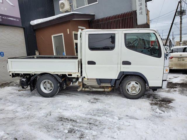 AT・4WD・エアコン・パワステ・冬タイヤ・後部ヒーター(8枚目)