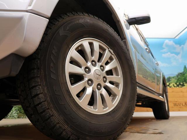 ロング GR 禁煙車 5MT車 4WD SDナビ バックカメラ HIDヘッドライト オートエアコン リアフォグ ETC 純正アルミホイール オートライト(14枚目)
