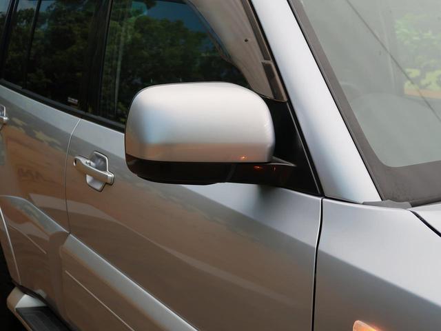 ロング GR 禁煙車 5MT車 4WD SDナビ バックカメラ HIDヘッドライト オートエアコン リアフォグ ETC 純正アルミホイール オートライト(24枚目)