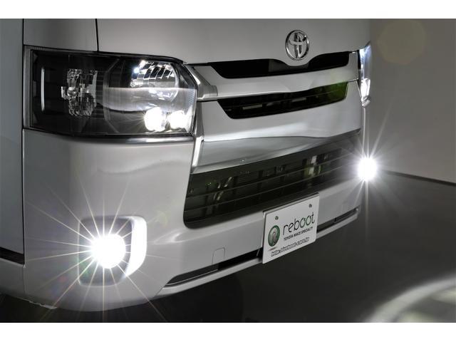 ロングDX GLパッケージ 両側スライドドア・リアヒーター・インナーブラックLEDヘッドライト・フォグランプ白/黄発光LED・ディーラーOPルーフキャリア&リアラダー・フルセグナビ・バックカメラ・荷台防汚カバー/ブラックトリム(8枚目)