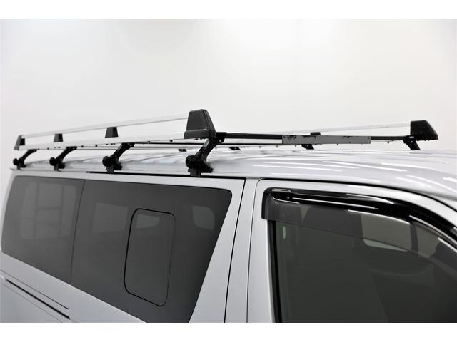 ロングDX GLパッケージ 両側スライドドア・リアヒーター・インナーブラックLEDヘッドライト・フォグランプ白/黄発光LED・ディーラーOPルーフキャリア&リアラダー・フルセグナビ・バックカメラ・荷台防汚カバー/ブラックトリム(11枚目)