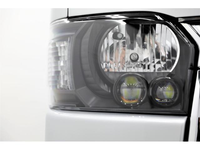 ロングDX GLパッケージ 両側スライドドア・リアヒーター・インナーブラックLEDヘッドライト・フォグランプ白/黄発光LED・ディーラーOPルーフキャリア&リアラダー・フルセグナビ・バックカメラ・荷台防汚カバー/ブラックトリム(19枚目)