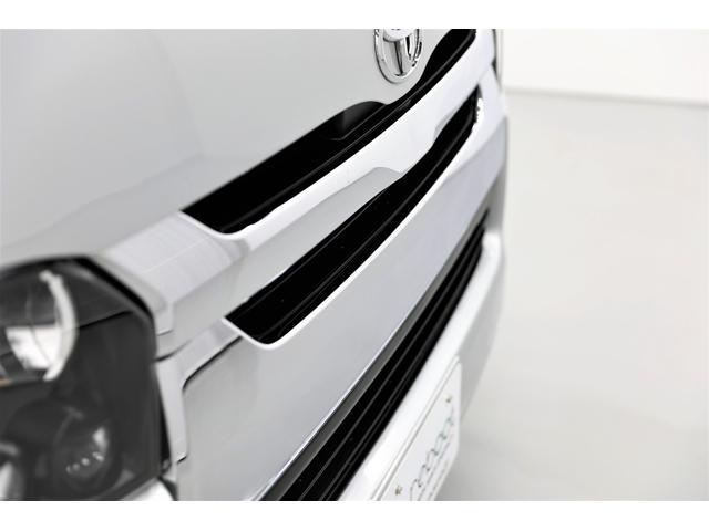ロングDX GLパッケージ 両側スライドドア・リアヒーター・インナーブラックLEDヘッドライト・フォグランプ白/黄発光LED・ディーラーOPルーフキャリア&リアラダー・フルセグナビ・バックカメラ・荷台防汚カバー/ブラックトリム(24枚目)