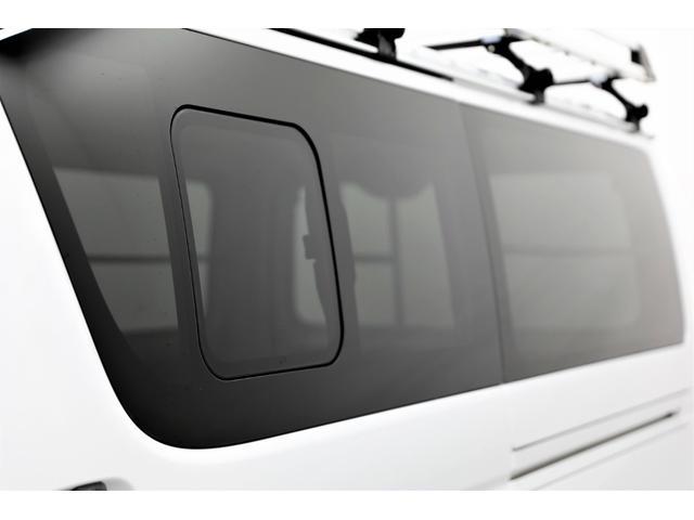 ロングDX GLパッケージ 両側スライドドア・リアヒーター・インナーブラックLEDヘッドライト・フォグランプ白/黄発光LED・ディーラーOPルーフキャリア&リアラダー・フルセグナビ・バックカメラ・荷台防汚カバー/ブラックトリム(29枚目)