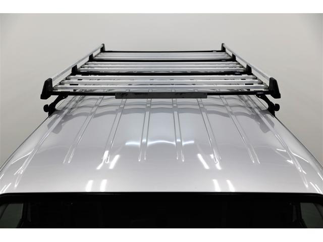 ロングDX GLパッケージ 両側スライドドア・リアヒーター・インナーブラックLEDヘッドライト・フォグランプ白/黄発光LED・ディーラーOPルーフキャリア&リアラダー・フルセグナビ・バックカメラ・荷台防汚カバー/ブラックトリム(74枚目)
