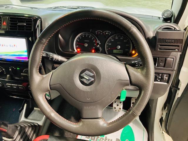 クロスアドベンチャー 4WD リフトアップ 社外マフラー 社外AW マッドタイヤ 社外バンパー 社外ナビ フルセグTV キーレス シートヒーター 新車保証書 取扱説明書(12枚目)