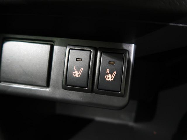 L 4WD HIDヘッドランプ 純正カーオーデイオ 横滑り防止装置 ヘッドライトレベライザー ETC シートヒーター アイドリングストップ 社外アルミホイール キーレスキー(7枚目)