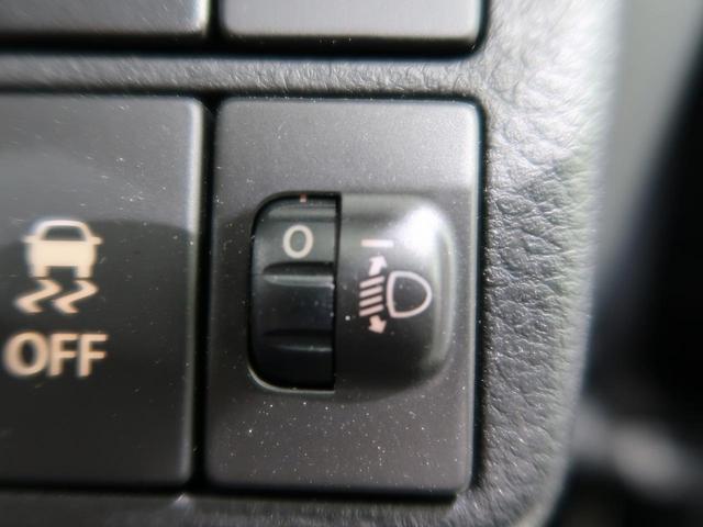L 禁煙車 4WD 前席シートヒーター アイドリングストップ 横滑り防止装置 ヘッドライトレベライザー キーレスエントリー 純正CDオーディオ 盗難防止システム(6枚目)