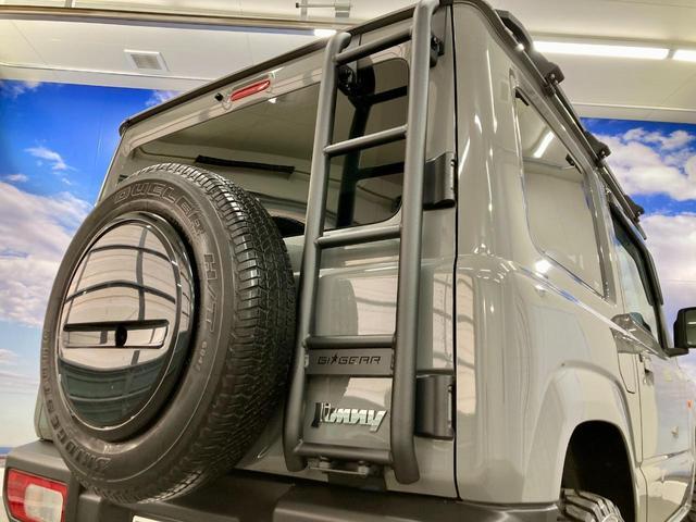 XL 4WD 寒冷地仕様 リフトアップ 本革S(社外) ESC シートヒーター 背面タイヤ 社外エアロ(F) ETC センターデフロック(24枚目)
