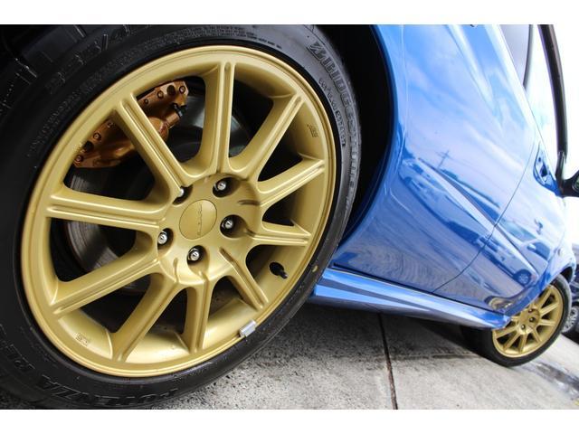 WRX STi E型 記録簿8枚 フジツボマフラー HKSEVC サブコン ブレンボキャリパー 純正17インチアルミ ETC 4WD キーレス ターボ 電動格納ミラー(46枚目)