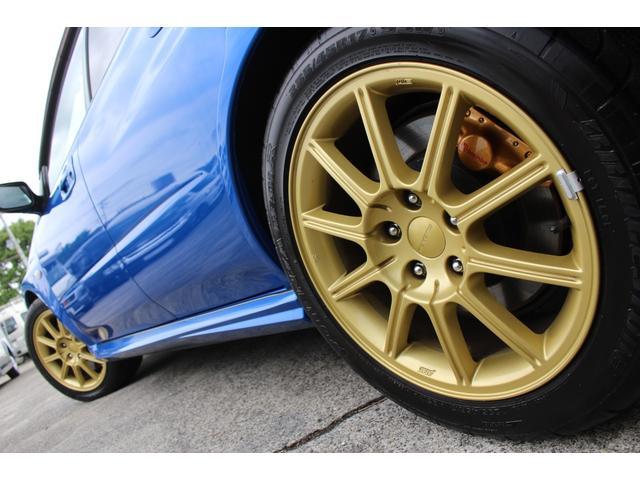 WRX STi E型 記録簿8枚 フジツボマフラー HKSEVC サブコン ブレンボキャリパー 純正17インチアルミ ETC 4WD キーレス ターボ 電動格納ミラー(53枚目)