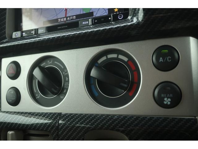 JPターボ 普通車登録 リフトUP 社外16インチAW オーバーフェンダー 社外バンパー ルーフラック ルーフLEDバー ヒッチメンバー 社外SDナビ フルセグ ETC 本革調シートカバー 社外LEDテール(28枚目)