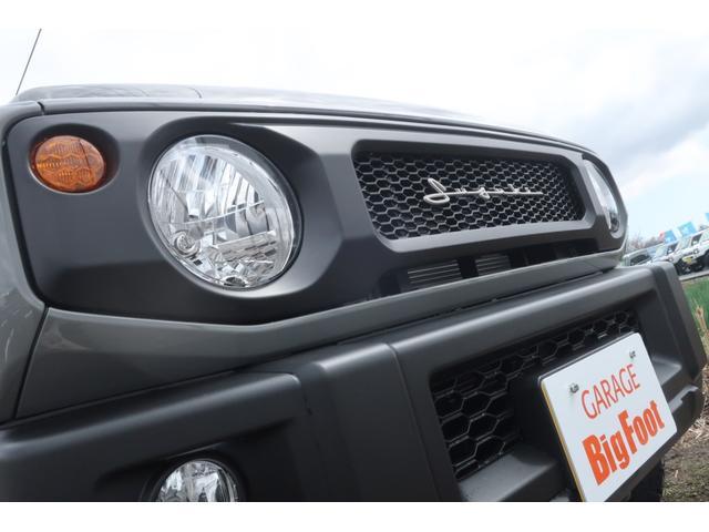 XL 5速マニュアル リフトアップ カスタムグリル 社外マフラー 新品16インチアルミホイール 新品ジオランダーM/Tタイヤ CDオーディオ ETC スマートキー  シートヒーター ヒーテッドドアミラー(7枚目)