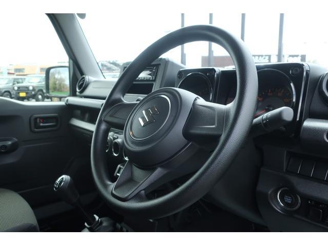 XL 5速マニュアル リフトアップ カスタムグリル 社外マフラー 新品16インチアルミホイール 新品ジオランダーM/Tタイヤ CDオーディオ ETC スマートキー  シートヒーター ヒーテッドドアミラー(9枚目)