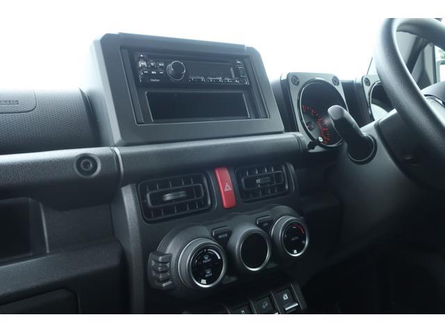 XL 5速マニュアル リフトアップ カスタムグリル 社外マフラー 新品16インチアルミホイール 新品ジオランダーM/Tタイヤ CDオーディオ ETC スマートキー  シートヒーター ヒーテッドドアミラー(31枚目)