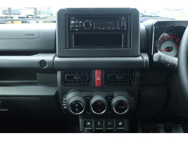 XL 5速マニュアル リフトアップ カスタムグリル 社外マフラー 新品16インチアルミホイール 新品ジオランダーM/Tタイヤ CDオーディオ ETC スマートキー  シートヒーター ヒーテッドドアミラー(33枚目)
