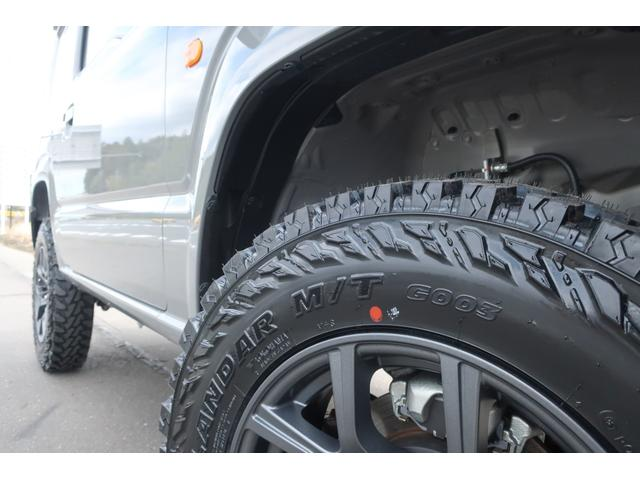 XL 5速マニュアル リフトアップ カスタムグリル 社外マフラー 新品16インチアルミホイール 新品ジオランダーM/Tタイヤ CDオーディオ ETC スマートキー  シートヒーター ヒーテッドドアミラー(64枚目)