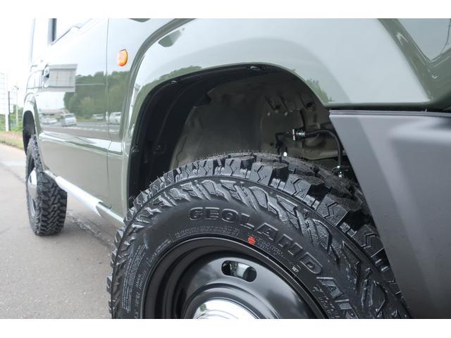 XC 届出済未使用車 陸送費無料 1.5インチリフトアップ 新品16インチホイール 新品ジオランダーM/Tタイヤ カスタムフロントグリル LEDヘッドライト スマートキー  シートヒーター(65枚目)