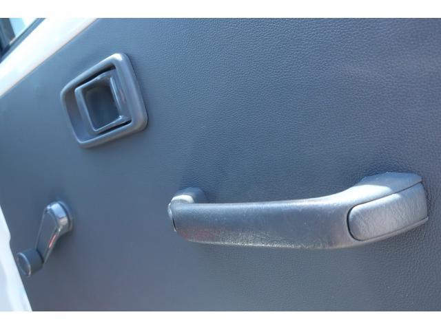 スペシャルクリーン パートタイム4WD 全塗装 社外14インチアルミ NANKANG M/Tタイヤ パワステ エアコン エアバッグ 集中ドアロック ドアバイザー ヘッドライトレベライザー 消火器 純正タイヤ4本付(10枚目)