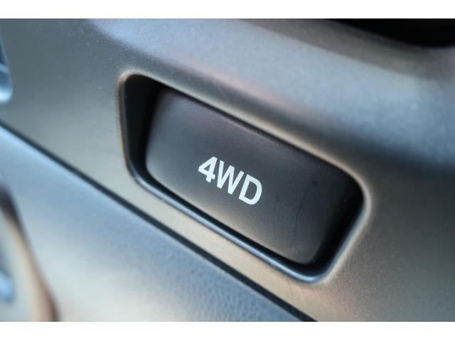 スペシャルクリーン パートタイム4WD 全塗装 社外14インチアルミ NANKANG M/Tタイヤ パワステ エアコン エアバッグ 集中ドアロック ドアバイザー ヘッドライトレベライザー 消火器 純正タイヤ4本付(28枚目)