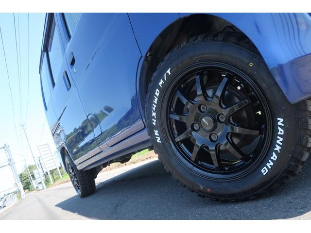 スペシャルクリーン パートタイム4WD 全塗装 社外14インチアルミ NANKANG M/Tタイヤ パワステ エアコン エアバッグ 集中ドアロック ドアバイザー ヘッドライトレベライザー 消火器 純正タイヤ4本付(61枚目)