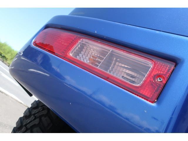 スペシャルクリーン パートタイム4WD 全塗装 社外14インチアルミ NANKANG M/Tタイヤ パワステ エアコン エアバッグ 集中ドアロック ドアバイザー ヘッドライトレベライザー 消火器 純正タイヤ4本付(70枚目)