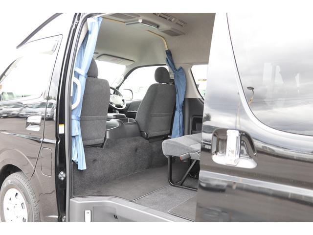 グランドキャビン 禁煙車 純正202ブラック メモリーナビ地デジフルセグTV ETC バックカメラ 後席モニター パワースライドドア 走行時リアクーラー&ヒーター カーテン AC100V(62枚目)
