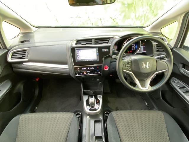 ハイブリッド・F 純正 7インチ メモリーナビ/ETC/EBD付ABS/横滑り防止装置/アイドリングストップ/エアバッグ 運転席/エアバッグ 助手席/パワーウインドウ/キーレスエントリー/オートエアコン ワンオーナー(4枚目)