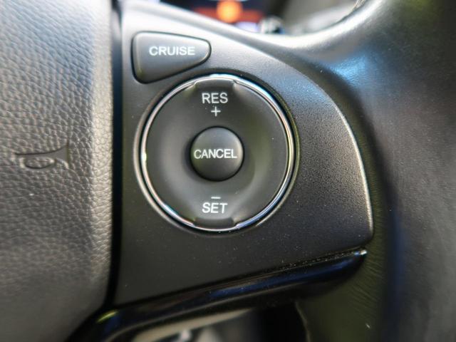 ハイブリッドZ・ホンダセンシング 禁煙車 純正7型ナビ フルセグTV バックカメラ クルーズコントロール LEDヘッドライト パドルシフト ルーフレール 黒ハーフレザーシート 純正17インチアルミ ETC スマートキー 電動格納ミラー(5枚目)