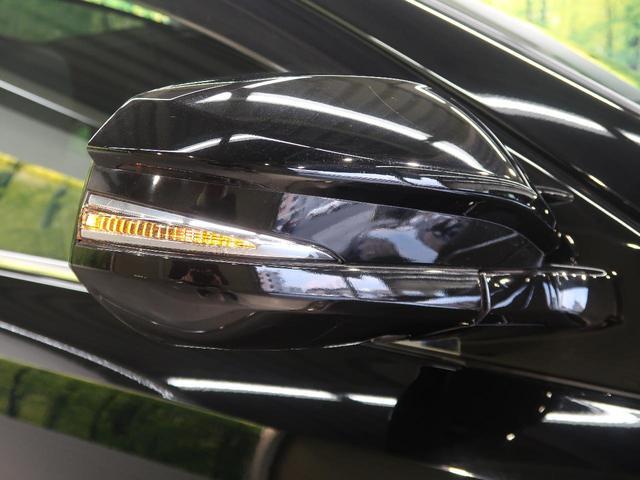 プレミアム ムーンルーフ クルーズコントロール 車線逸脱警報 オートハイビーム 純正ナビ LEDヘッド フォグ ブラックコンビシート シートヒーター オートデュアルエアコン ステアリングスイッチ 純正18AW(35枚目)