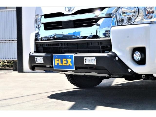 GL ハイエースワゴンGL・4WD・オリジナル内装架装Ver1・ノーマル車高・16インチアルミホイール・モンスタータイヤ・新型・6型ハイエース・ナビ・ETC・フリップダウンモニター・オリジナルシートカバー(26枚目)