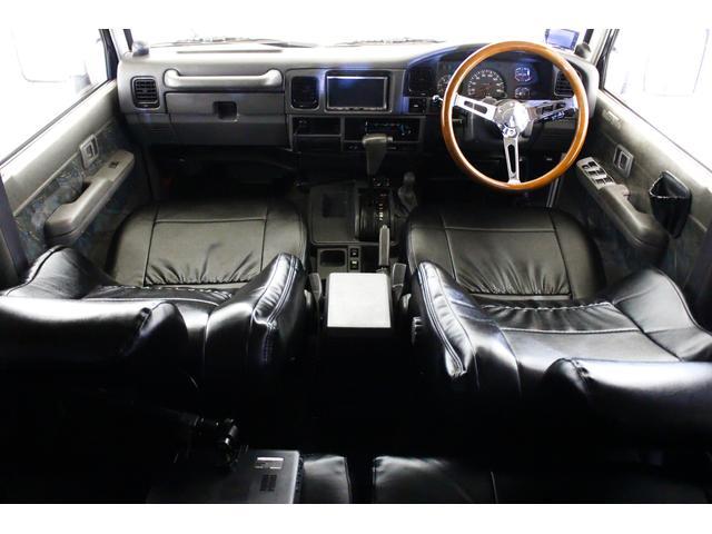 SXワイド 4WD タイベル交換済 黒レザー調シートカバー(3枚目)