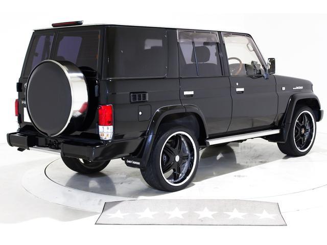 SXワイド 4WD タイベル交換済 黒レザー調シートカバー(15枚目)