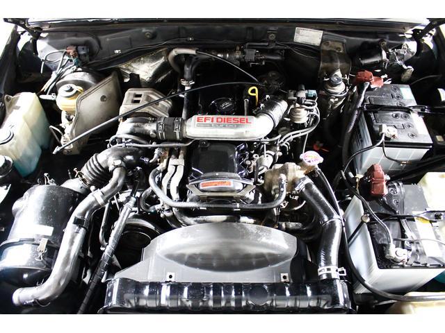 SXワイド 4WD タイベル交換済 黒レザー調シートカバー(5枚目)