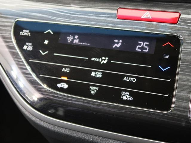 ハイブリッドアブソルート・ホンダセンシンアドバンスP メーカーナビ 全周囲カメラ 1オーナー ホンダセンシング レーダークルーズ 両側電動スライド 7人乗り LEDヘッド オートライト パワーシート 純正17AW スマートキー プッシュスタート(49枚目)