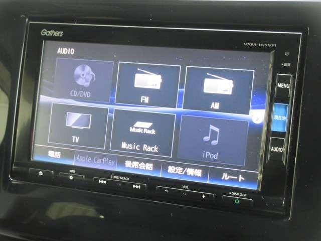 ナビゲーションはホンダ純正メモリーナビ VXM-165VFi が装着されております。AM、FM、CD、DVD再生、音楽録音再生、フルセグTV、Bluetoothがご使用いただけます。初めて訪れた場所で