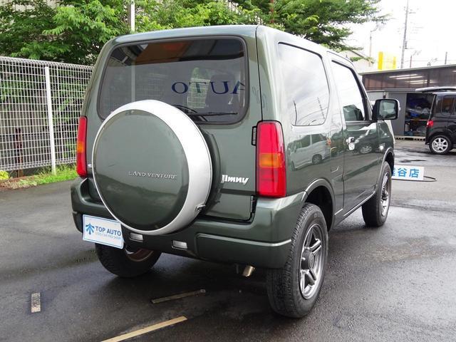 ランドベンチャー 切替式4WD ターボ 10型 5速マニュアル ワンオーナー ナビ TV ETC ハーフレザーシート シートヒーター 純正アルミ キーレスキー DVD再生 CD Bluetooth接続(30枚目)