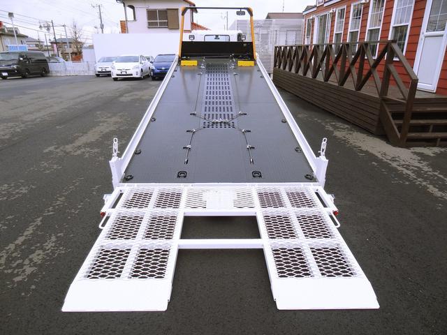 積載車 古河ユニック 超超ロング 開閉式横あおり・固ばく装置(3枚目)