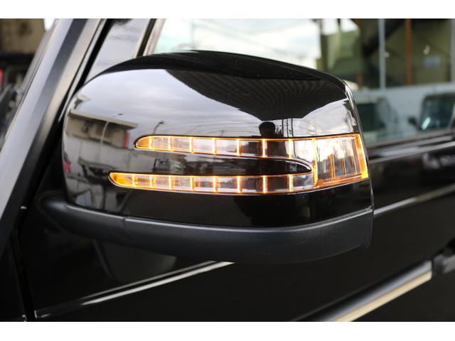 G550 G63仕様/20インチアルミ/サイド出しマフラー/AMGスカッフプレート/黒本革シート/シートヒーター/スライディングルーフ/ディストロニックプラス/ハーマンカードン/ウッドコンビハンドル(34枚目)