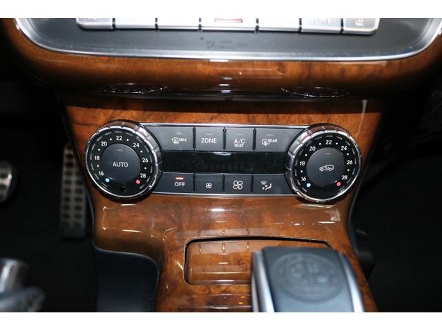G550 G63仕様/20インチアルミ/サイド出しマフラー/AMGスカッフプレート/黒本革シート/シートヒーター/スライディングルーフ/ディストロニックプラス/ハーマンカードン/ウッドコンビハンドル(54枚目)