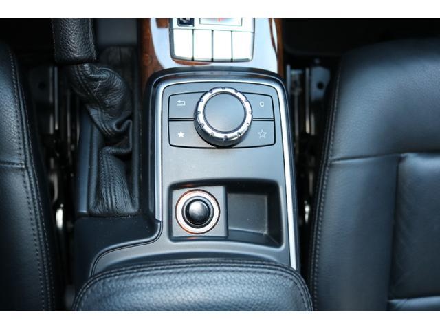 G550 G63仕様/20インチアルミ/サイド出しマフラー/AMGスカッフプレート/黒本革シート/シートヒーター/スライディングルーフ/ディストロニックプラス/ハーマンカードン/ウッドコンビハンドル(55枚目)