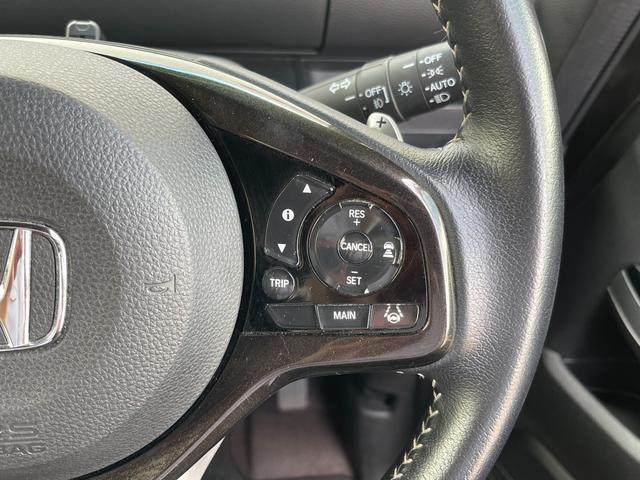 G・Lターボホンダセンシング 衝突軽減ブレーキ 誤発進抑制機能 車線維持支援システム 路外逸脱抑制機 アダプティブクルーズコントロール アイドリングストップ 純正SDナビ フルセグTV 両側パワースライドドア バックカメラ(7枚目)