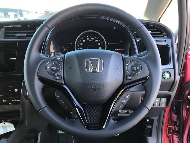 ハイブリッドZ ホンダセンシング 登録済み未使用車(11枚目)