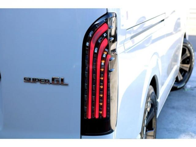 スーパーGL ダークプライムII ディーゼル 2WD 5型 パールホワイト フロントスポイラー 17インチアルミ ナスカータイヤ LEDテール フロア施工 SDナビ ETC バックカメラ LEDヘッドライト スマートキー(12枚目)