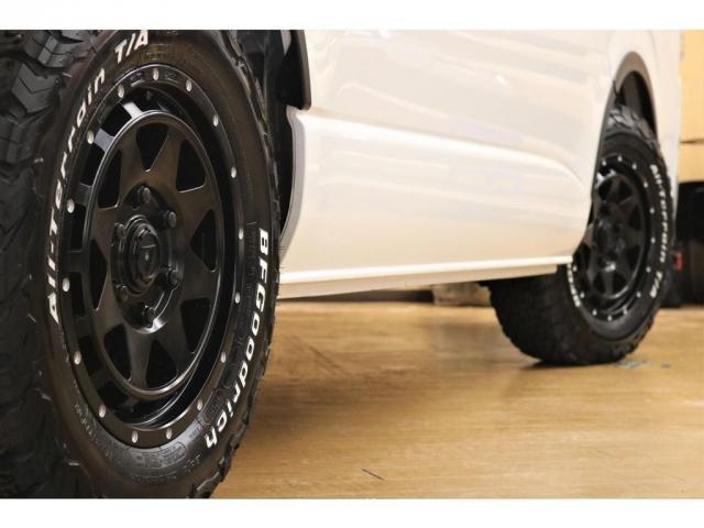 GL ガソリン 4WD 6型 パールホワイト フロントバンパーガード オーバーフェンダー 16インチアルミ オールテレーンタイヤ ベッドキット テーブルキット フロア施工 シートカバー SDナビ ETC(8枚目)