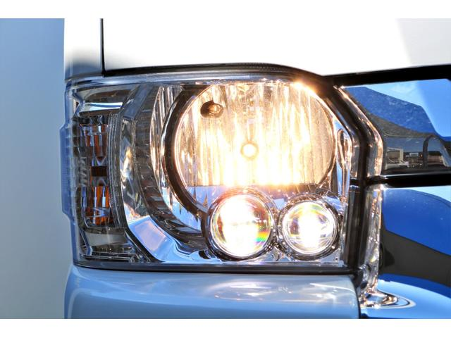 GL ガソリン 4WD 6型 パールホワイト フロントバンパーガード オーバーフェンダー 16インチアルミ オールテレーンタイヤ ベッドキット テーブルキット フロア施工 シートカバー SDナビ ETC(24枚目)