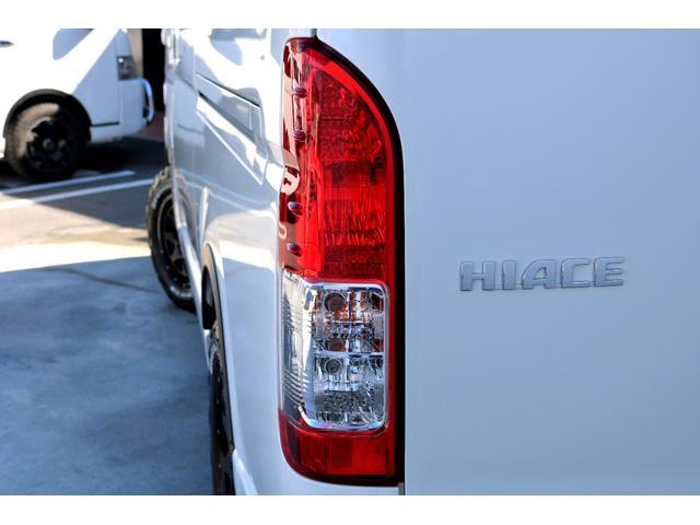 GL ガソリン 4WD 6型 パールホワイト フロントバンパーガード オーバーフェンダー 16インチアルミ オールテレーンタイヤ ベッドキット テーブルキット フロア施工 シートカバー SDナビ ETC(29枚目)