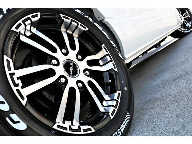 DX ワイド スーパーロング GLパッケージ ハイエースバン DX スーパーロング ディーゼルターボ 4WD 6型 パールホワイト  フロア施工 17インチアルミ オーバーフェンダー フロントスポイラー LEDテールランプ 8インチSDナビ(33枚目)
